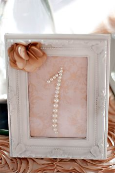 sweet pearl table numbers...maybe with burlap in the background instead