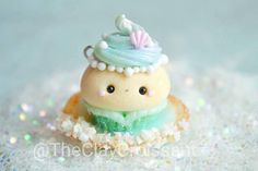 This listing is for 1 Mermaid Cupcake Charm (jump ring included). Charm is made out of polymer clay, detailed with chalk pastel and finished with a glaze for protection and shine. Measures about 1 inch tall and about 5/8 inch wide. and sits inside a little sea shell that has been