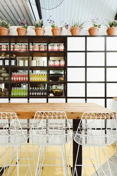 Techne Architects created a modern Mexican vibe in their design for Fonda Windsor in Melbourne, using sombrero-shaped chandeliers, hand-strung rope benches, and