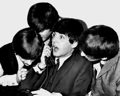 She said what? Ringo Starr, 23, John Lennon, 23 and George Harrison, 20, all gathered around Paul McCartney, 21, while he took a call at the Plaza Hotel.
