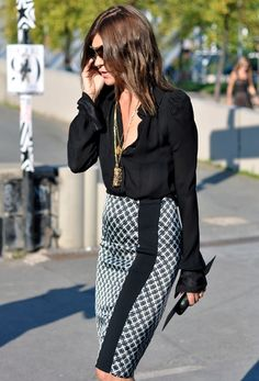 Great skirt paired with a chic black blouse.