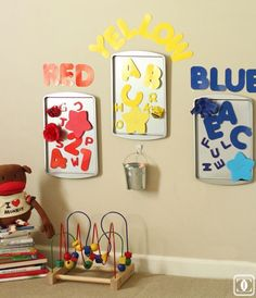 I really like the idea of hanging cookie sheets from the dollar store on the classroom wall. You can use these for centers or sensory. And it saves you table space.