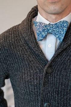 Add this tie to your outfit and people will be dreaming of beautiful white orchids. This floral tie is the perfect accessory for men's sweater outfits, spring casual, or even summer outfits. The elegant white on blue floral pattern is subtle but unique. This tie matches well with casual men's outfits and more upscale dressy looks. #bowtie #floral #sweater Mens Fashion Sweaters, Mens Fashion Wear, Suit Fashion, Sweater Outfits, Men's Outfits, Men Sweater, Summer Outfits, Tie Matching, Suit Up