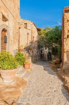 Small alley in the Tuscan village via MuralsYourWay.com