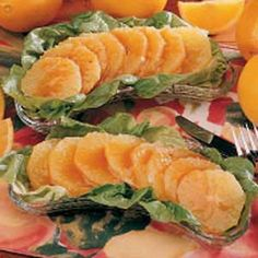 Orange Salad with Honey Dressing Recipe -This light refreshing salad is perfect for a ladies' luncheon. The delicate, flavorful dressing goes so well with the orange slices. On a bed of green lettuce, it looks as good as it tastes.                                           —Diane Hixon, Niceville, Florida