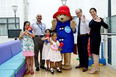 Paddington poses with some of the staff and children at The Royal Alexandra Children's Hospital in Brighton.