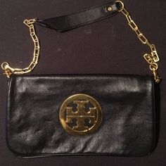 Black and gold purse Tory Burch inspired purse. It has the logo on the outside of the bag. Logo slightly scratched. Bags Mini Bags