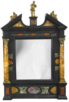 ITALIAN, TUSCANY, EARLY 17TH CENTURY TABERNACLE FRAME gilt bronze-mounted, hardstone-inlaid and mounted ebonized wood, now mounted with mirror glass 18 3/4 by 12 1/4 in., 47.6 by 31.1 cm.