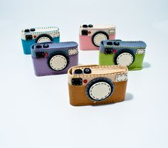 FELT CAMERA CASES BY P. NAKAMURA    $16.95  Amazing all-felt camera cases by Japanese zakka maker, Prime Nakamura. These charming felt cases are perfect for your point-and-shoot or other small items. When you go to take a picture, what's more appealing than opening up your bag and finding this whimsical vintage design?