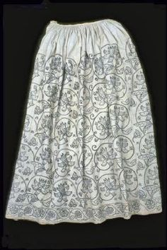 Skirt    A rare woman's skirt made from fustian, a mix of linen and cotton, and embroidered with large floral patterns. Museum of London