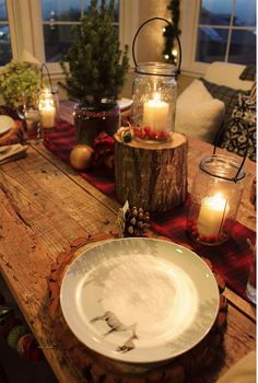 Rustic cabin Christmas. Love the table and the warm glow from the candles. #Tablescapes