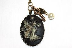 Fairy Cameo Necklace by ExploreBelieveCreate on Etsy https://www.etsy.com/listing/230548849/fairy-cameo-necklace