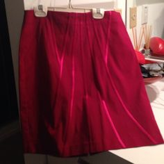 Red mini skirt Red miniskirt in stretch material with satin accents. Back zip but versatile size due to stretch fabric. Poleci Skirts Mini