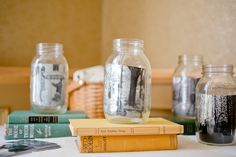 I had a photo table at my #wedding, which included our engagement photos in mason jars on top of colorful vintage books! Photo Credit: http://juliewilliamsphotography.ca/