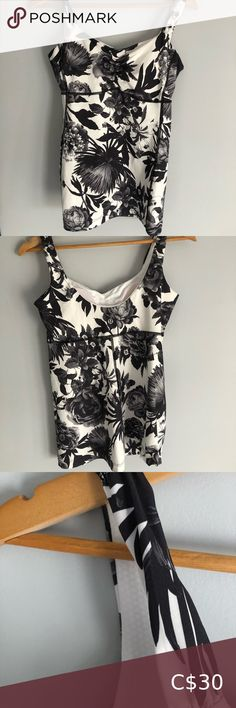 Lululemon floral tank top Black and white floral tank top with built in bra with pads. Fits size small/medium Condition is like new lululemon athletica Tops Floral Tank Top, Floral Maxi Dress, Lululemon Hoodie, Lululemon Athletica, Denim Overall Dress, V Neck Tank Top, How To Roll Sleeves, Vintage Jeans, Super Skinny Jeans