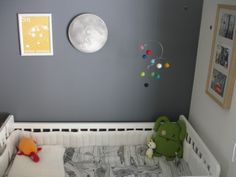 Science nursery with moon and planets mobile over the crib