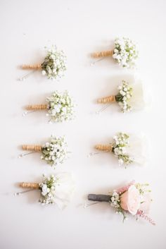 Baby's Breath Boutonnieres | Groom: Pink rose | Father of the Bride: White rose