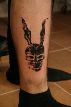http://tattoomagz.com/rabbits-tattoos-on-bodies/black-adorable-rabbit-tattoo-on-leg/