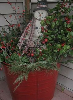 Outdoor Christmas Decoration Ideas - Old Red Bucket...stuffed with Christmas Greenery - Click Pic for 20 Front Porch Christmas Decorating Ideas