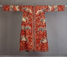 """Rock (Banyan) Early 18th Century India for the Dutch Market """"Tailored from Indian chintz, the painted pattern of pine trees and prunus blossoms on a red ground consciously imitates the type of pattern that would be found on a Japanese kimono. Unlike..."""