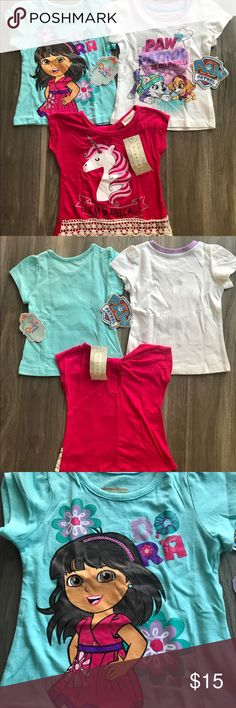 Bundle of tees for girls Three shirts for little girls.  Size - 2T NWT Comes from smoke and pet free home. Dora and Paw patrol brand is Nickelodeon The shirt with Unicorn  is Btween Nickelodeon Shirts & Tops Tees - Short Sleeve