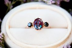 Alexandrite diamond three stone engagement ring, oval diamond ring, unique engagement ring, black di This beautiful, vintage inspired ring is made with a stunning Chatham alexandrite and black diamond side stones. Ring details: -Main stone is a Chath Unique Diamond Rings, Diamond Wedding Rings, Bridal Rings, Unique Rings, Oval Diamond, Vintage Diamond, Wedding Band, Three Stone Engagement Rings, Vintage Engagement Rings
