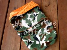 Minky swaddle blanket- orange with green and brown camoflage- baby minky swaddle wrap READY TO SHIP. $38.99, via Etsy.