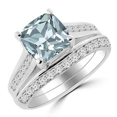Jewelry Point - Cushion-Cut Aquamarine Diamond Engagement Wedding Ring Set, $1,300.00 (https://www.jewelrypoint.com/cushion-cut-aquamarine-diamond-engagement-wedding-ring-set/)