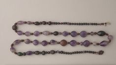 String of Beads. Necklace from Abydos.  Middle Kingdom, 12th Dynasty, ca. 1985-1773 BC.  Amethyst and hematite. Now in the World Museum, Liverpool.
