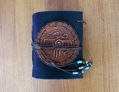 leather notebook crow by PairOfHandsLeather on Etsy