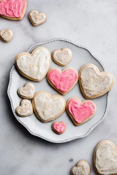 Valentine's Day Heart Sugar Cookies with Cream Cheese Frosting - These adorable cookies are easy to make and are the perfect Valentine's Day treat! Soft, just the right amount of sweet, and topped with a creamy cream cheese frosting and fun sprinkles. So much YUM! #valentinesdesserts #valentinesdaydesserts #valentinesrecipes #valentinesdayrecipes #sugarcookies #frostedsugarcookies #dessertrecipes #cookies #frosting #softsugarcookies #cookierecipes #bluebowlrecipes | bluebowlrecipes.com Soft Frosted Sugar Cookies, Sugar Cookie Frosting, Cookie Recipes, Dessert Recipes, Desserts, Baking Recipes, Baking Tips, Drink Recipes, Easy Recipes
