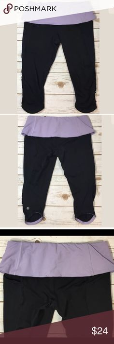 "🌈PRICE DROP🌈 Lululemon Nothing to Hide Crops Lululemon ""Nothing to Hide"" black crops with ruffle trim on legs. Light purple/lavender elastic foldover waistband. Inner drawstring.  I don't see a size label, but all of the other Lulu pants I purchased at this time are a 6, and these are similar. All brands are sized differently. Please review measurements to ensure a proper fit.   Waist: 26-32"" Inseam: 15"" Rise: 7.5"" with waistband folded  2 small spots on back of waistband as shown…"