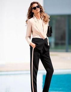 MadeleineTuxedo pants with coordinating color blocked blazer with rhinestone embellished shell.