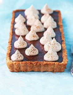 This is an impressive tart that could even be served as an alternative to coffee at a special dinner. The hazelnut pastry goes beautifully with the rich coffee and dark chocolate filling and can be made in advance. Finish with a lovely boozy Kahlúa cream.