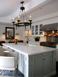 Pale grey island, white cabinets, stainless and chrome   Island - Benjamin Moore Fieldstone, Marble countertop.