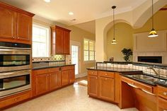 Knee space under sinks... Wide open spaces, double oven, cook for me hubby!