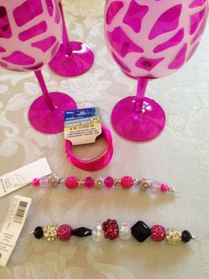 wire & beads used to embellish bottle cap wine charms; pink wine glasses given to bride, MOH, MOB, MOG with wine charms on the stems
