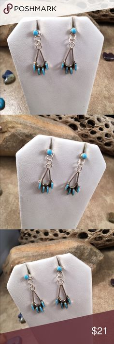 Zuni Needle Point Turquoise Dangle Earrings These are handmade Zuni Needle Point Turquoise  & Sterling Silver Dangle earrings.  The length is right at 1 1/4 inches long and the width is just under 1/2 of an inch (at the widest point. They are made by the artist Ashley Laate.