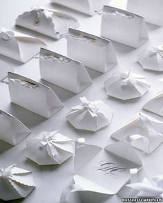 Use any basic card stock for all of these small boxes.Pyramid Box1. Enlarge the template, trace it onto paper, and cut it out. Make slits as marked with a utility knife. Using a bone folder, score the paper on the dotted lines.2. Fold up all four flaps, forming a pyramid. Cut two pieces of ribbon, each one long enough to wrap around the box. Starting on what will be the inside of the box, slip one ribbon through a slit, wrap around outside, and slip through opposite side. Pull ribbon so…