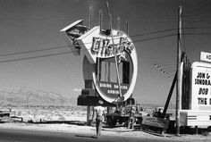 1941 vintage Las Vegas - Installing the first neon sign on the Las Vegas Strip. El Rancho Vegas (1941-1960) sign by YESCO....