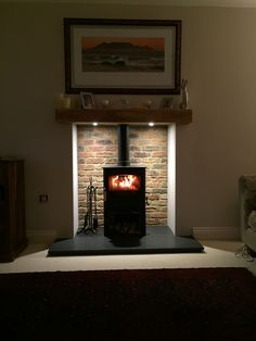Good Absolutely Free Brick Fireplace log burner Style Sometimes it will pay to help omit your redecorate! Rather than extracting a aged brick fireplace , reduce costs nonethe Brick Fireplace Log Burner, Small Fireplace, White Fireplace, Living Room With Fireplace, Fireplace Design, Fireplace Mantels, Fireplace Ideas, Mantel Ideas, Electric Stove Fireplace