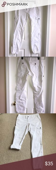 Boston Proper white cargo pants Boston Proper white lightweight cargo pants, drawstring at the ankles, two buttons tab at the bottom and inner straps to roll up and adjust from long pants to capris length. Preowned in excellent condition no stains. Size: 8. Waist: 16 inches. Inseam: 32 inches. Boston Proper Pants