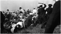 Police used guns, clubs, and tear gas to attack marching strikers outside Chicago's Republic Steel plant, May 30, 1937. Photo credit: Carl Linde / AP