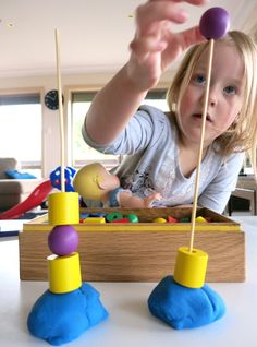 building activity with wooden lacing beads, skewers, and playdough