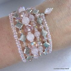 This is the Queen of Rose Quartz This artisan made 6 loop memory wire wrap bracelet cuff is loaded with 8 mm and 6 mm round Rose Quatz gemstone beads. The gems are accompanied by lots 10 mm and 6 mm s