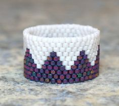 My Aunt Robyn makes these! They are so perfect and delicate- you can hardly feel them when you're wearing them. Crown Peyote Ring by PeyoteRings.com