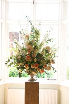 2. Urn arrangement with more roses and flowers