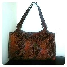 """Genuine Leather Indian handbag. (Express) Beautiful, multi colored floral design in durable leather. Handmade in India so it's topnotch quality. In excellent, like new condition. Dimensions are 13"""" W x 7.5"""" H. Not too large not too small. A good size for a night on the town! Express Bags Shoulder Bags"""