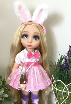 A customer's photo of her repainted Rapunzel Disney Animator doll (painted as a custom Alice in Wonderland).  I love the whimsical purse and bunny ears with this outfit!