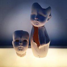 Ceramic doll heads and a bowling pin body attached to a figurative feel to the piece. Lighting is something I just tried for display experimentation